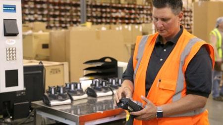 Distribution center Supervisor looking at barcode scanner
