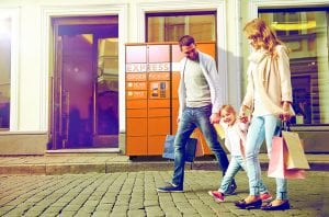 family walking with locker in background