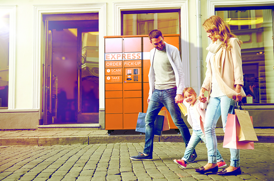 A young family walks through a city shopping district with Apex Order Pickup Lockers