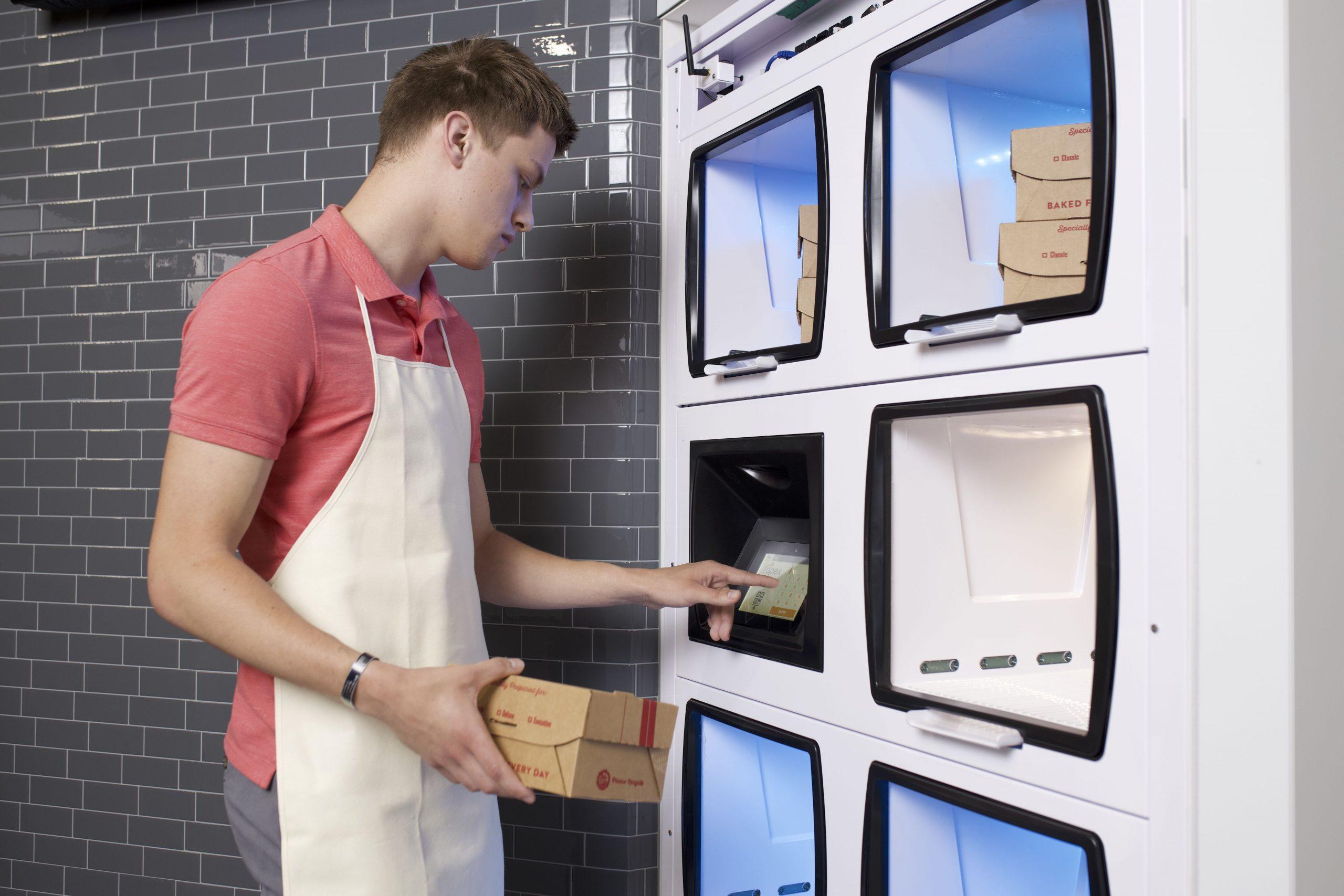 Restaurant employee loads order into Flow-Thru