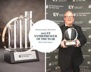 Kent Savage holding EOY Award