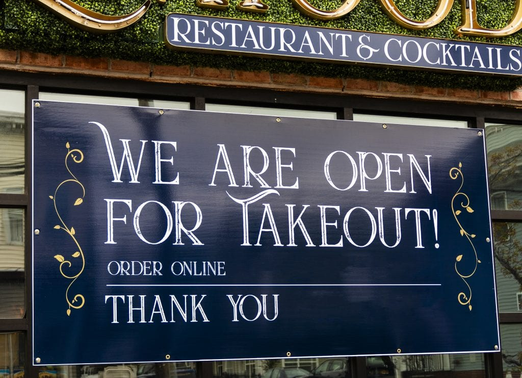 Open for Takeout sign in restaurant