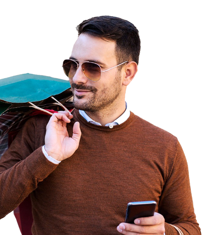 Retail shopper carrying bags and mobile phone